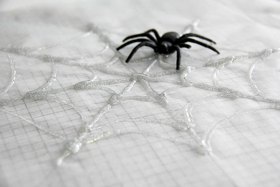 How to make hot glue spider webs for Halloween